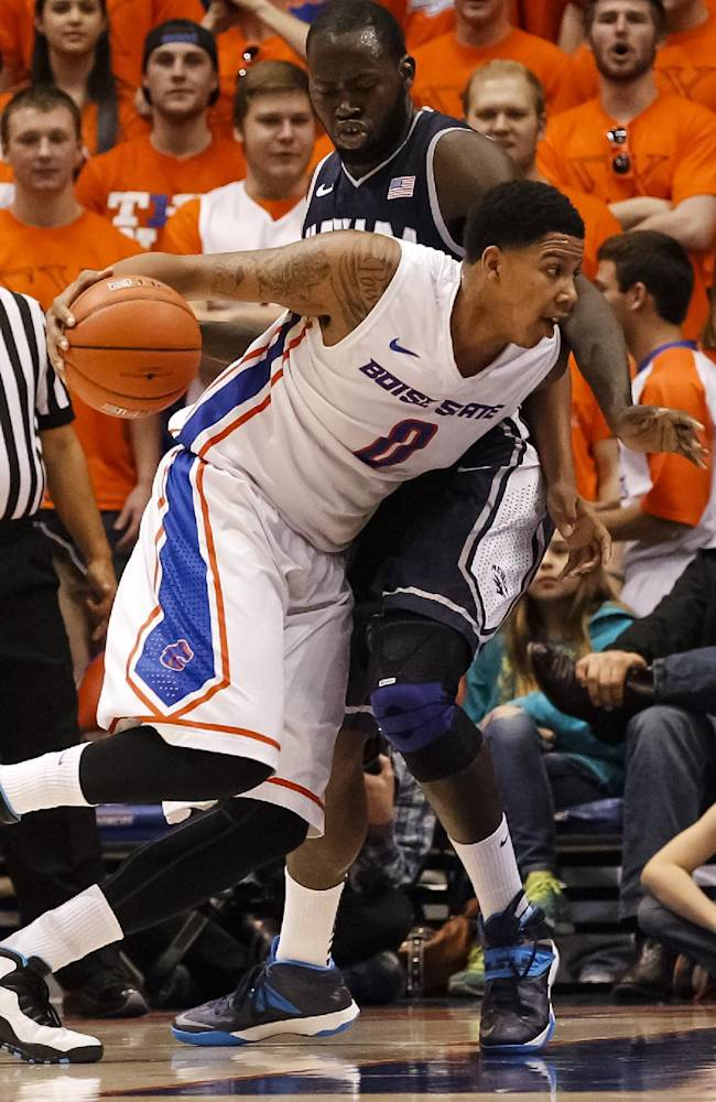 Boise State's Ryan Watkins (0) drives the ball past Nevada's Ali Fall (21) during the first half of an NCAA college basketball game in Boise, Idaho, on Wednesday, March 5, 2014. Nevada won in double overtime 83-81