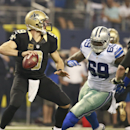 New Orleans Saints quarterback Drew Brees (9) is pressured by Dallas Cowboys defensive tackle Henry Melton (69) during the first half of an NFL football game Sunday, September 28, 2014 in Arlington, Texas. The Associated Press