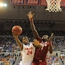 Florida's Casey Prather (24) tries to get to the basket as Alabama center Moussa Gueye (14) defends during the second half of an NCAA college basketball game in Gainesville, Fla., Saturday, March 2, 2013. (AP Photo/Phil Sandlin)