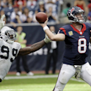 Houston Texans' Matt Schaub throws while being rushed by Oakland Raiders' Lamarr Houston (99) during the second half of an NFL football game Sunday, Nov. 17, 2013, in Houston The Associated Press