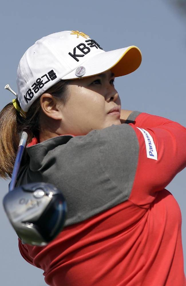 Park In-bee of South Korea watches her shot on the ninth hole during the first round of the LPGA KEB Hana Bank Championship golf tournament at Sky72 Golf Club in Incheon, west of Seoul, South Korea, Friday, Oct. 18, 2013. Park In-bee finished her first round with a two-under par 70