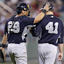 New York Yankees catcher Francisco Cervelli (29) talks to starting pitcher David Phelps (41) after giving up a two-run RBI double in the sixth inning of an exhibition baseball game against the New York Yankees in Fort Myers, Fla., Thursday, March 20, 2014