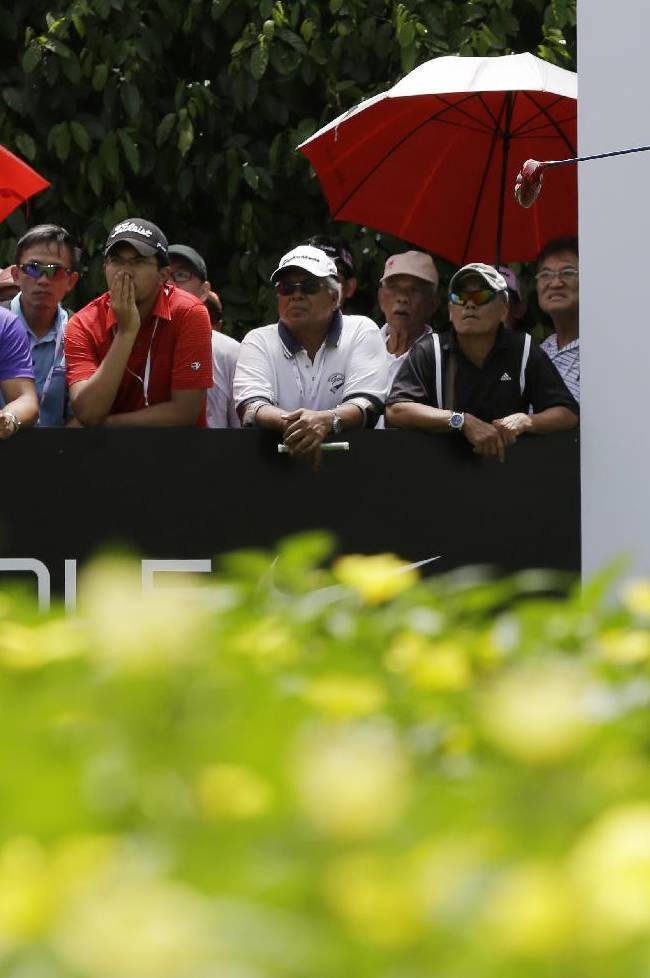 Norway's Suzann Pettersen watches her tee shot on the 10th hole during her final round at the Malaysian LGPA event in Kuala Lumpur, Sunday, Oct. 13, 2013