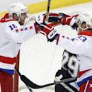 Washington Capitals' Eric Fehr (16) celebrates his goal with Jay Beagle (83) during the first period of an NHL hockey game against the Pittsburgh Penguins in Pittsburgh, Saturday, Dec. 27, 2014. (AP Photo/Gene J. Puskar)