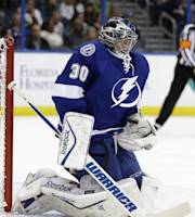 Tampa Bay Lightning goalie Ben Bishop stops a shot by the New York Islanders during the first period of an NHL hockey game Thursday, March 27, 2014, in Tampa, Fla. (AP Photo/Chris O'Meara)