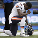 Chicago Bears' Josh Morgan kneels on the field before a preseason NFL football game against the Seattle Seahawks, Friday, Aug. 22, 2014, in Seattle The Associated Press