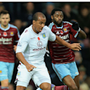 West Ham United's Alex Song, right, and Aston Villa's Gabriel Agbonlahor compete for the ball during their English Premier League soccer match at Upton Park, London, Saturday, Nov. 8, 2014