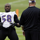 Baltimore Ravens linebacker Elvis Dumervil, left, stretches during a training camp practice, Thursday, July 24, 2014, at the team's practice facility in Owings Mills, Md. (AP Photo) The Associated Press