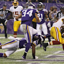Washington Redskins wide receiver Pierre Garcon (88) catches an 8-yard touchdown pass ahead of Minnesota Vikings strong safety Mistral Raymond, center, and strong safety Andrew Sendejo (34) during the first half of an NFL football game Thursday, Nov. 7, 2