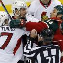 Ottawa Senators' Kyle Turris, left, and Minnesota Wild's Chris Stewart, right, mix it up briefly as Ottawa Senators' Milan Michalek, second from left, of Czech Republic, joins the fray in the first period of an NHL hockey game, Tuesday, March 3, 2015, in St. Paul, Minn. No penalties were called. (AP Photo/Jim Mone)
