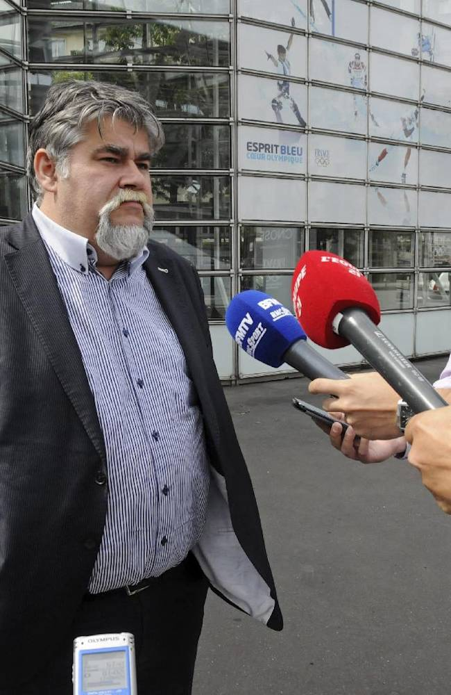 This Wednesday Aug. 20, 2014 photo shows Jerome Ducros, president of Luzenac football club in the French Pyrenees, speaking to reporters after meeting French league officials at an arbitration hearing at the Paris headquarters of the French Olympic Committee. The small club earned promotion from League 3 last season and should now be playing in the professional League 2 but is being refused admittance on administrative grounds, provoking intense debate in France about the impact of money on football