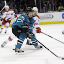 San Jose Sharks' Logan Couture (39) controls the puck in front of Carolina Hurricanes defenseman Ron Hainsey during the first period of an NHL hockey game on Tuesday, March 4, 2014, in San Jose, Calif The Associated Press