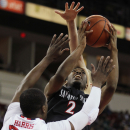 San Diego State's Xavier Thames shoots over Fresno State's Marvelle Harris during the first half of an NCAA college basketball game in Fresno, Calif., Saturday, March 1, 2014 The Associated Press