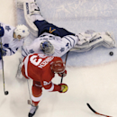 Toronto Maple Leafs goalie James Reimer (34) deflects a shot by Detroit Red Wings left wing Johan Franzen (93) of Sweden during the third period of an NHL hockey game in Detroit, Wednesday, Dec. 10, 2014. Reimer made 41 saves in the Leafs' 2-1 shootout wi