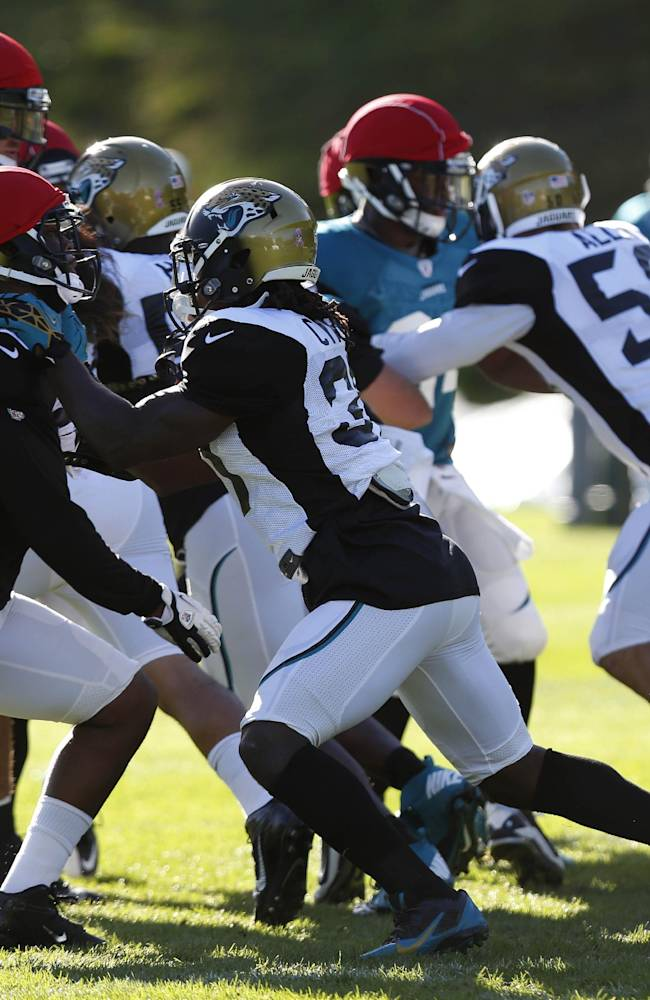 Jacksonville Jaguars' take part in a football practice at the Pennyhill Park Hotel and Spa in Bagshot, England, Wednesday, Oct. 23, 2013. The Jaguars face the San Francisco 49ers on Sunday in a NFL football game at Wembley Stadium in London