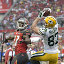 Green Bay Packers wide receiver Jordy Nelson (87) pulls in a 19-yard pass in front of Tampa Bay Buccaneers cornerback Johnthan Banks (27) during the fourth quarter of an NFL football game Sunday, Dec. 21, 2014, in Tampa, Fla. (AP Photo/Phelan M. Ebenhack)
