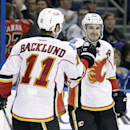 Calgary Flames left wing Curtis Glencross, right, celebrates with center Mikael Backlund, of Sweden, after scoring against the Tampa Bay Lightning during the third period of an NHL hockey game on Thursday, April 3, 2014, in Tampa, Fla. The Flames won the