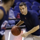 Virginia head coach Tony Bennett participates with his team during practice for an NCAA college basketball game at the Atlantic Coast Conference tournament in Greensboro, N.C., Wednesday, March 13, 2013. (AP Photo/Gerry Broome)