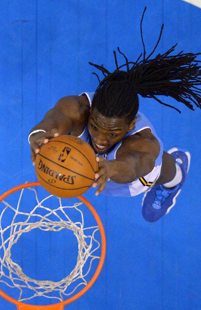 Denver Nuggets forward Kenneth Faried dunks during the second half of an NBA basketball game against the Los Angeles Clippers, Tuesday, April 15, 2014, in Los Angeles. The Clippers won the game 117-105