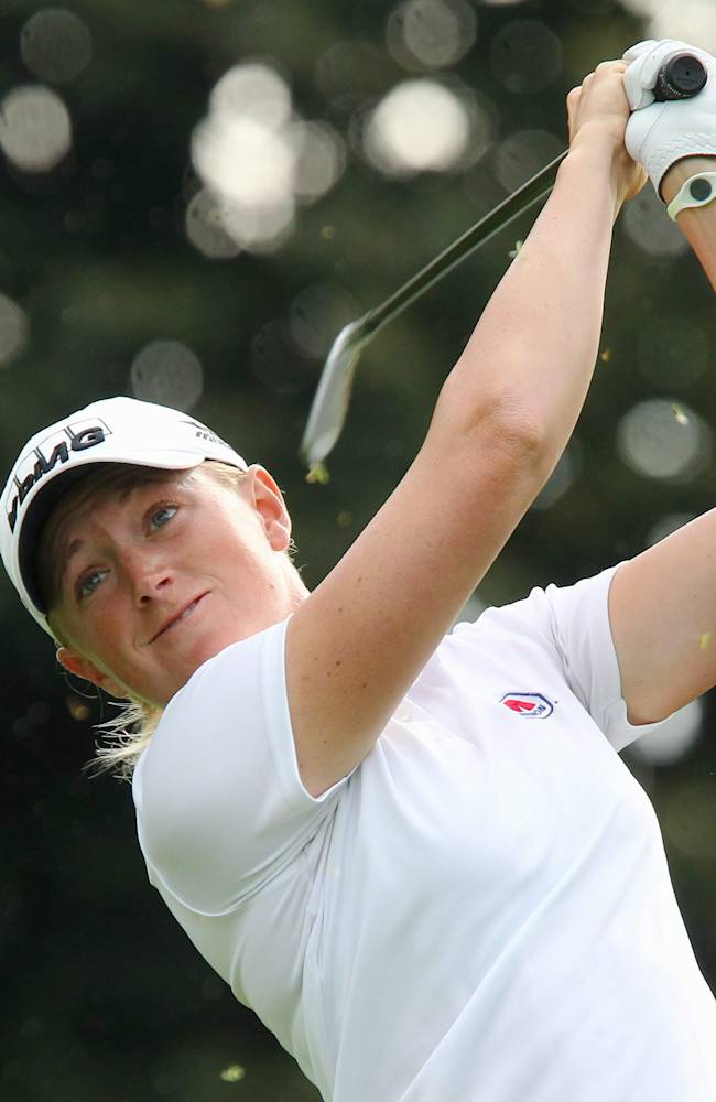 Stacy Lewis hits her tee shot on the 17th hole at the Canadian Pacific Women's Open golf tournament in London, Ontario, Thursday, Aug. 21, 2014