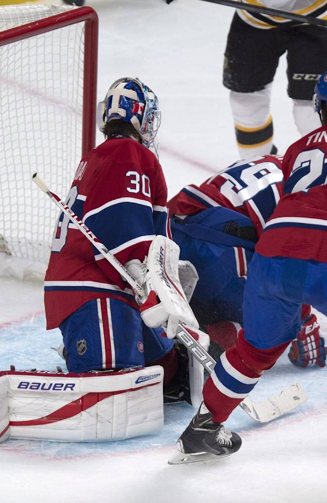 Boston Bruins' Patrice Bergeron celebrates his goal past Montreal Canadiens goalie Peter Budaj during second period NHL hockey action Wednesday, March 12, 2014 in Montreal