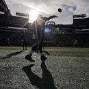 Seattle Seahawks quarterback Russell Wilson warms up before the NFL football NFC Championship game against the Green Bay Packers Sunday, Jan. 18, 2015, in Seattle The Associated Press