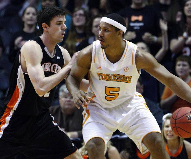 FILE -- In this March 20, 2013 file photo, Tennessee forward Jarnell Stokes (5) works against Mercer forward Daniel Coursey in the NIT college basketball tournament in Knoxville, Tenn. Stokes received some brutally honest feedback when he considered entering the NBA Draft after his sophomore season. He took that criticism to heart during the offseason by losing weight and developing a more well-rounded game