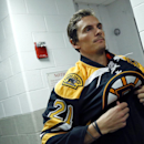Boston Bruins hockey left wing Loui Eriksson puts his jersey on to take a formal head shot for the team photographer at TD Garden in Boston, Thursday, Sept. 18, 2014 The Associated Press