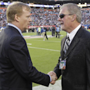 In this Feb. 7, 2010, file photo, NFL Commissioner Roger Goodell, left, shakes hands with Indianapolis Colts owner Jim Irsay before the start of the NFL Super Bowl XLIV football game between the Colts and New Orleans Saints in Miami. The NFL suspends Irsa