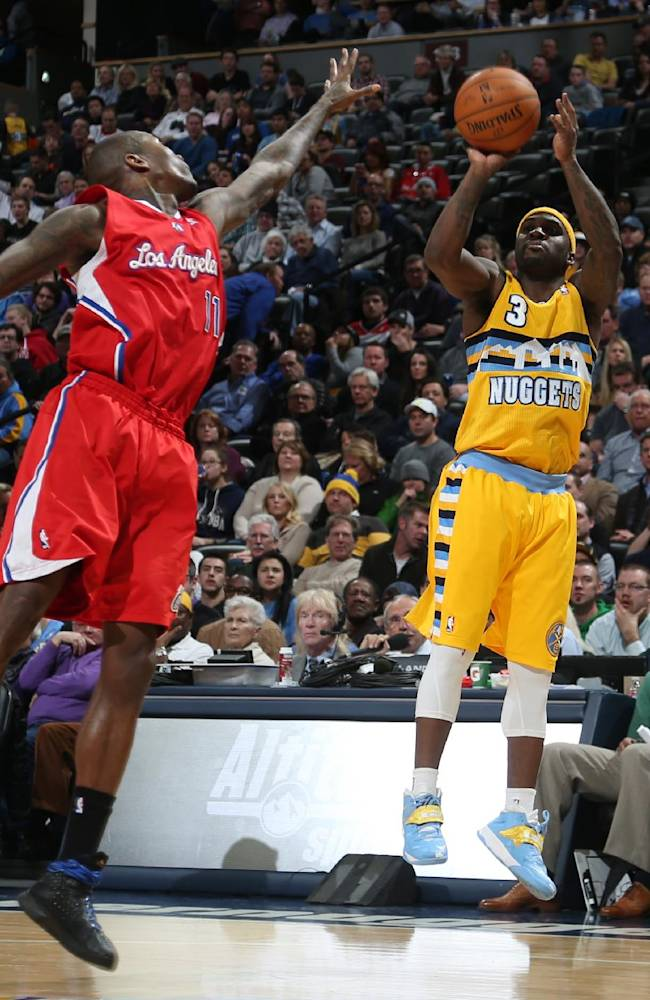 Denver Nuggets guard Ty Lawson, right, goes up for shot over Los Angeles Clippers guard Jamal Crawford in the fourth quarter of the Nuggets' 116-115 victory in an NBA basketball game in Denver, Monday, Feb. 3, 2014