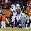 Indianapolis Colts wide receiver Hakeem Nicks (14) celebrates his touchdown with teammate Dwayne Allen (83) as Denver Broncos cornerback Bradley Roby (29) looks away during the second half of an NFL divisional playoff football game, Sunday, Jan. 11, 2015,