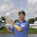 Padraig Harrington poses for photographers after winning the Honda Classic golf tournament, Monday, March 2, 2015, in Palm Beach Gardens, Fla. Harrington defeated Daniel Berger in a two hole playoff. (AP Photo/Luis M. Alvarez)