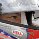 In this photo taken on Friday, May 17, 2013, Marco Andretti sits in his car during practice for the Indianapolis 500 auto race at the Indianapolis Motor Speedway in Indianapolis. (AP Photo/Darron Cummings)