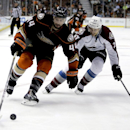 Anaheim Ducks center Nate Thompson, left, knocks the puck away from Colorado Avalanche defenseman Bruno Gervais during the second period of an NHL hockey preseason game in Anaheim, Calif., Monday, Sept. 22, 2014 The Associated Press