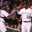 Colorado Rockies catcher Wilin Rosario, left, congratulates relief pitcher LaTroy Hawkins after he retired the Philadelphia Phillies in the ninth inning to earn his fifth save of the season and preserve the Rockies' 3-1 victory in a baseball game in Denve