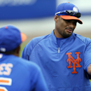 In this March 1, 2013, photo, New York Mets pitcher Johan Santana, right, talks to bullpen coach Ricky Bones before the Mets' spring training baseball game against the Detroit Tigers in Port St. Lucie, Fla. The Mets have declined a $25 million option on t