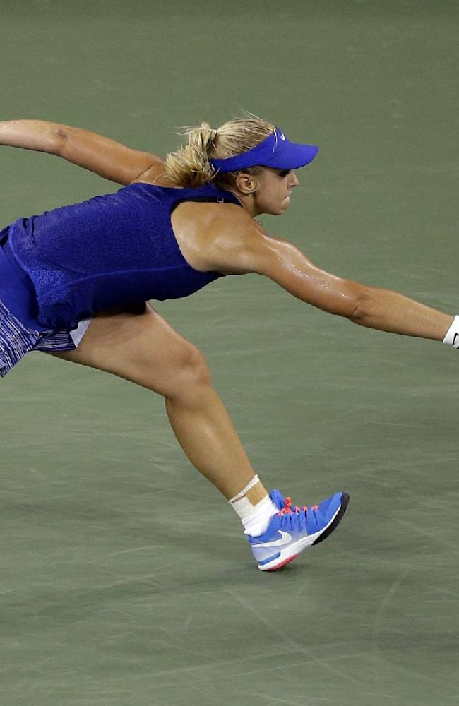 Sabine Lisicki, of Germany, reaches for a shot by Maria Sharapova, of Russia, during the third round of the U.S. Open tennis tournament, Friday, Aug. 29, 2014, in New York