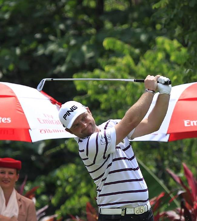 Andy Sullivan of England tees off on the eighth hole during the third round of the Malaysian Open golf tournament at Kuala Lumpur Golf and Country Club in Kuala Lumpur, Malaysia, Saturday, April 19, 2014