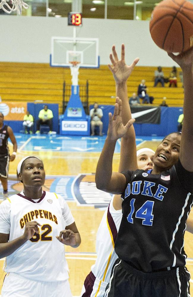 Duke's Ka'lia Johnson, right, goes up for the basket against pressure from Central Michigan's Jordan LaDuke, rear, as Jas'Mine Bracey, left, looks on during the first half of an NCAA college basketball game in St. Thomas, U.S. Virgin Islands, Friday, Nov. 29, 2013. Duke won 97-64