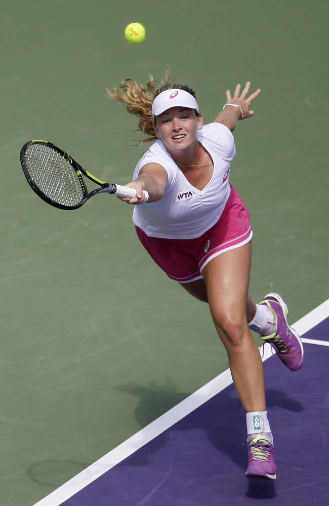 Sharapova rallies past Flipkens at Key Biscayne