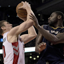 Toronto Raptors forward Tyler Hansbrough, left, drives into New Orleans Pelicans guard Tyreke Evans during fourth quarter NBA action in Toronto, Monday, Feb. 10, 2014 The Associated Press