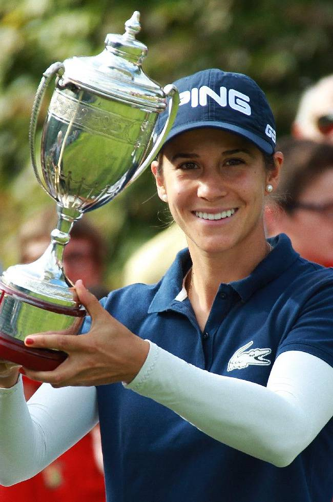 Azahara Munoz of Spain holds her trophy at the women's Open in Saint Jean de Luz, southwestern France, Sunday, Sept.29, 2013