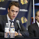 Chicago Blackhawks' Jonathan Toews, left, speaks as Patrick Kane listens during a news conference at the United Center in Chicago, Wednesday, July 16, 2014. The Blackhawks recently agreed to eight-year contract extensions with Toews and Kane The Associate