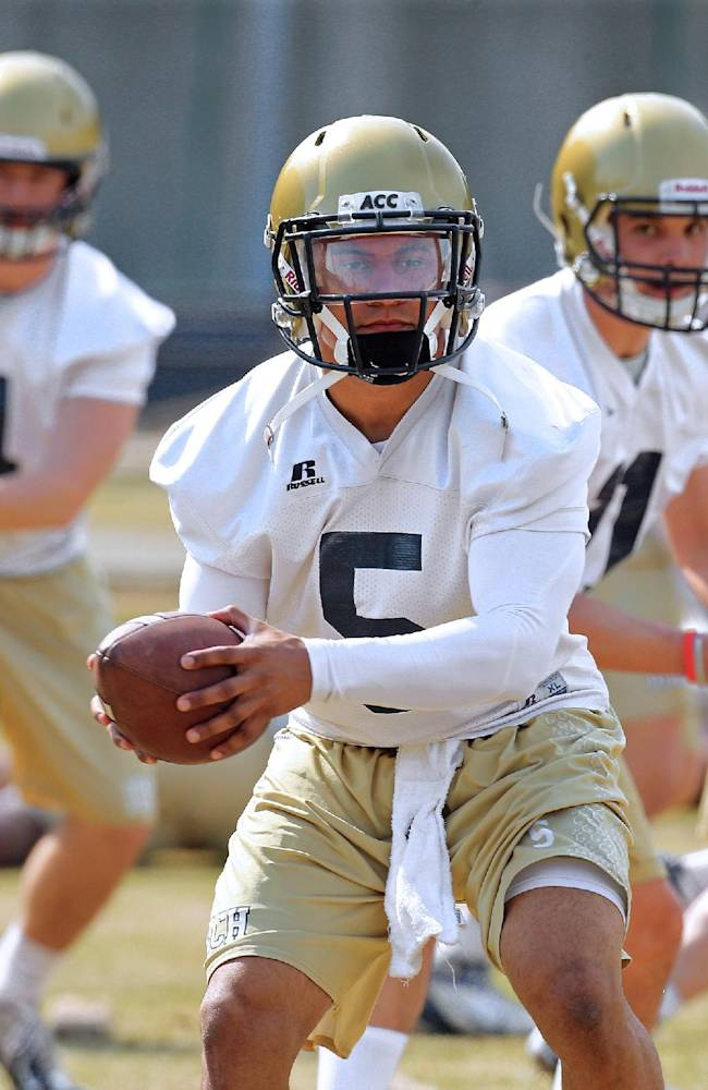 Georgia Tech quarterbacks, from left,   Brady Swilling,  Justin Thomas, and freshman Matthew Jordan run through drills on the first day of spring football practice on Monday, March 24, 2014, in Atlanta
