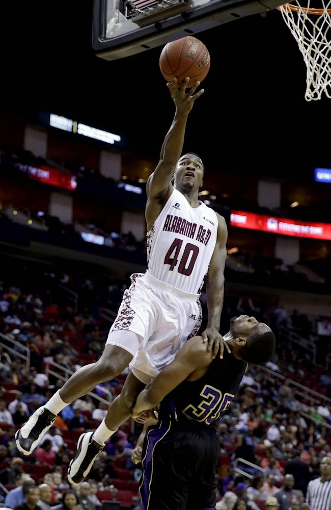 Alabama A&M's Brandon Ellis (40) goes up for a shot over Prairie View A&M's Reggis Onwukamuche (35) during the first half of an NCCA college basketball game in the semifinals of the Southwestern Athletic Conference tournament Friday, March 14, 2014, in Houston