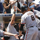 Members of the San Francisco Giants congratulate Hunter Pence after Pencdsse scored on a two run homer by Buster Posey against the San Diego Padres in the first inning a baseball game Sunday, April 20, 2014, in San Diego The Associated Press