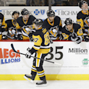 Pittsburgh Penguins' Sidney Crosby (87) is greeted by teammates on the bench after scoring in the shootout of an NHL hockey game against the New York Rangers, Saturday, Nov. 15, 2014, in Pittsburgh. The Penguins won 3-2 in a shootout The Associated Press