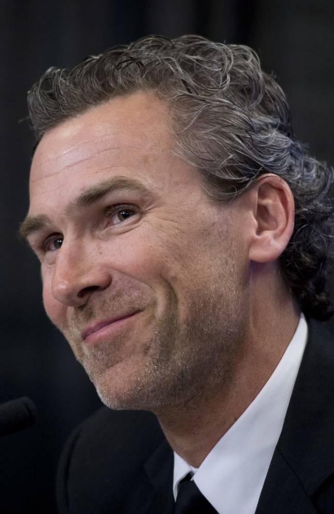 Former Vancouver Canucks captain Trevor Linden smiles during a press conference in Vancouver on Wednesday, April 9, 2014. Linden has been hired as Vancouver's president of hockey operations