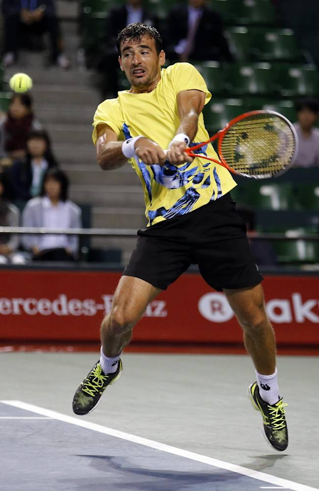 Ivan Dodig of Croatia returns the ball to Jarkko Nieminen of Finland during the quarterfinal of the Japan Open Tennis Championships in Tokyo, Friday, Oct. 4, 2013