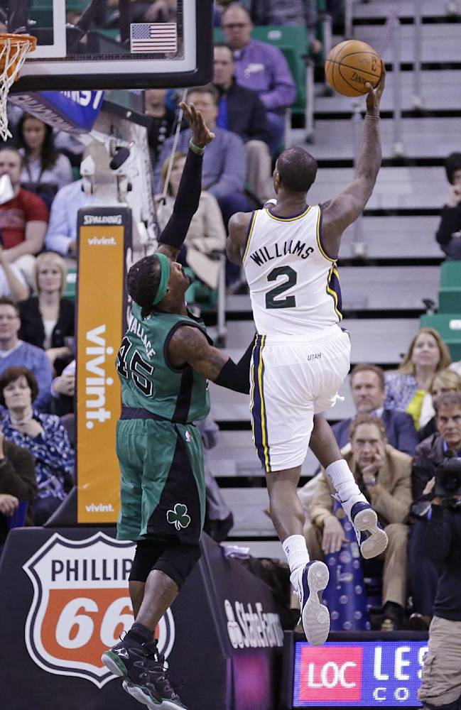 Utah Jazz's Marvin Williams (2) shoots as Boston Celtics' Gerald Wallace (45) defends in the second quarter of an NBA basketball game, Monday, Feb. 24, 2014, in Salt Lake City